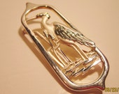 Vintage Vittorio brooch design of a egret done in both silver and gold plating very modernistic