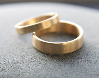 3mm + 5mm wedding band set in 18ct yellow gold, featuring flat profile and brushed finish - made to order from recycled gold