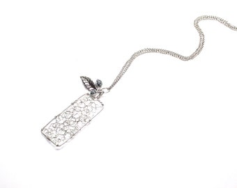 Wire wrapped pendant with beads and leaf charm, curlicue design, rectangle shape, silver toned long chain necklace