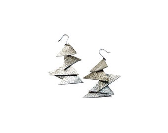 Leather earrings. Dangling earrings, recycled leather effect metal triangles.