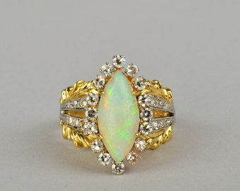 A fabulous 18 Kt antique Harlequin opal and diamond ring