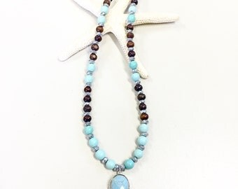 Turquoise bezel necklace in silver with turquoise, wood, and rondelle beads