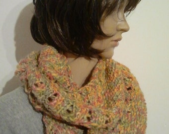 Knitted Möbiusschal of colourful Wick yarn in green, yellow, Orange and grey