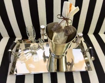Stunning Chrome Serving Tray with Sleek Body & Striking Horn Handles.
