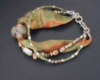Lampwork, silver, pearls and silk multi strand bracelet