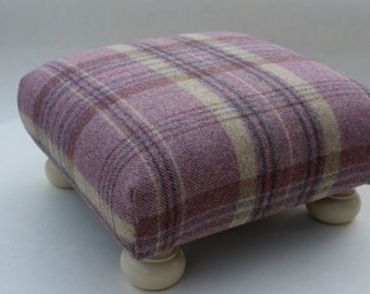 Footstool upholstered in mauve tweed with painted turned legs
