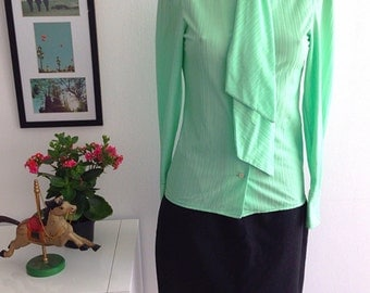Vintage blouse green pistachio. Long sleeve lacing in the neck