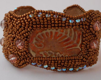 Bead Embroidered Cuff with metal stamp focal by Cathy Helmers