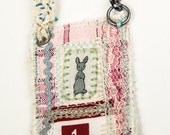 Miniature art quilt, wearable necklace, mixed media, rabbit
