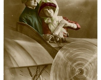 1912 Hand Tinted Romantic Couple in an Aeroplane Postcard Antique Vintage RPPC