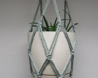 Faded cyan (bluish green) cotton macrame plant hanger. Flowerpot hanger