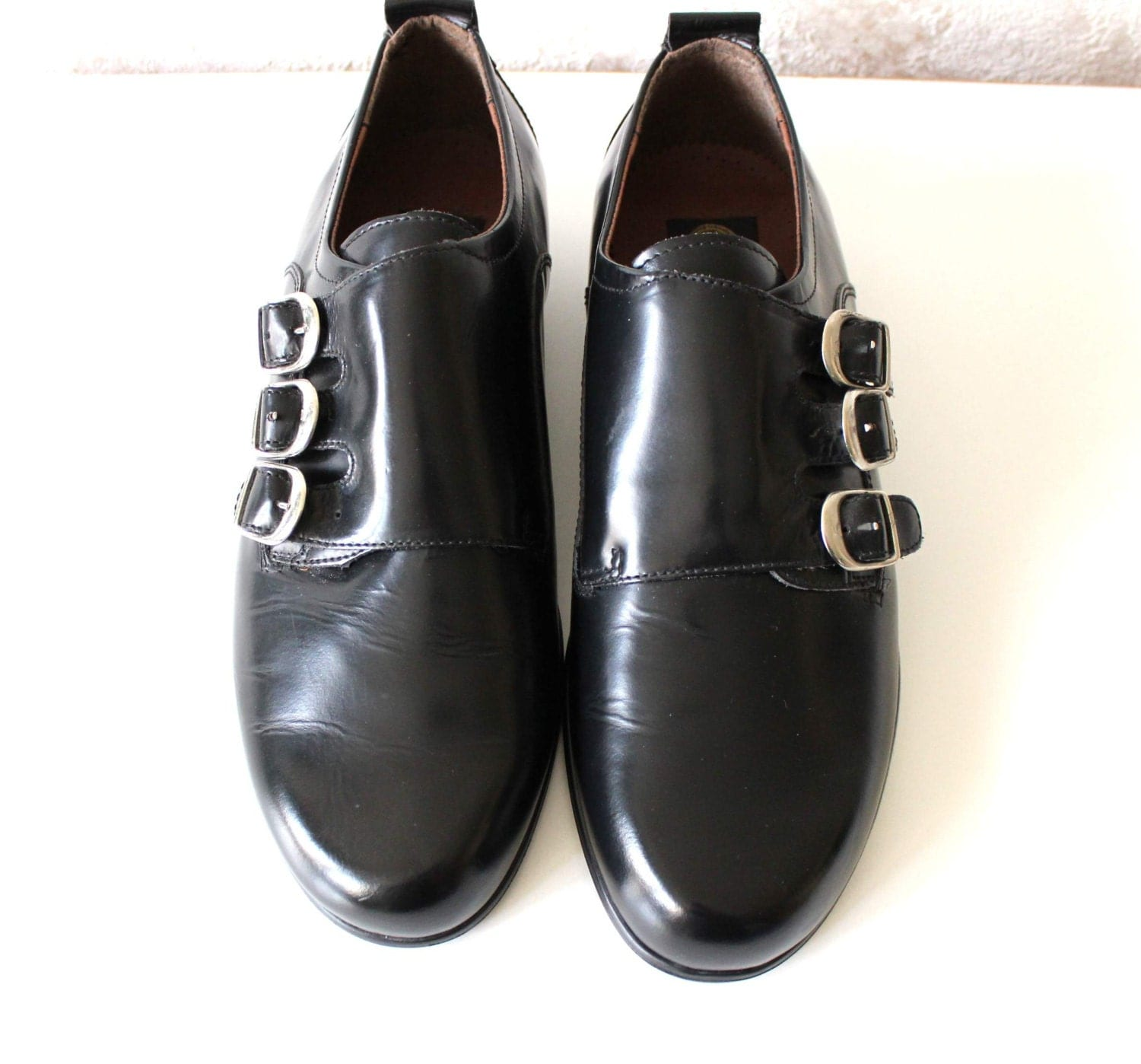 shiny black leather monk dress shoes with metal buckles eu