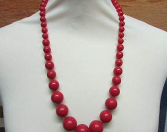1980s red graduated plastic bead necklace