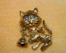 Vintage 1980's Rhinestone Blued Eyed Kitten, Cat, Feline Brooch, Cat with a Bell, Bell Ringer, Pin, Meow, Kitty Kat Jewelry
