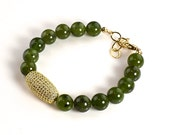 """LP 1250  """"One Bracelet Only""""  Round Jade Beaded Bracelet With A Swarovski Crystal Rhinestone Barrel Bead In A Pave Setting"""