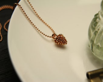 Necklace with pine cone rose gold plated