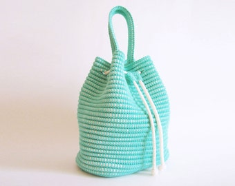 Crochet pattern for a drawstring bag. Practice tapestry crochet, pattern includes chart with symbols, images, written instructions
