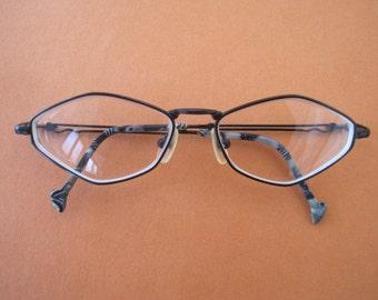funky unusual shaped black metal eyeglasses.