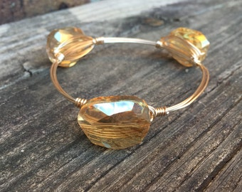 The Gold Glass and Sass bangle inspired by Bourbon and Bowties, wire wrapped bracelet
