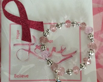 Breast cancer pink with sterling silver charm bracelet PJ