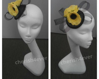 Small comb black and yellow fascinator