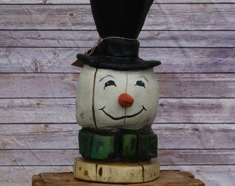 Snowman Head, Chainsaw carving, Painted and sealed.          All one of a kind