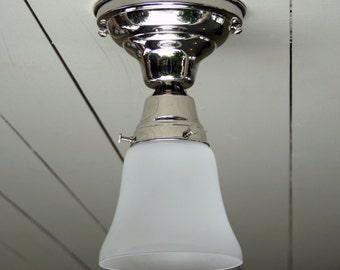 Vintage / Antique style, flush mount, polished nickel, single ceiling light.