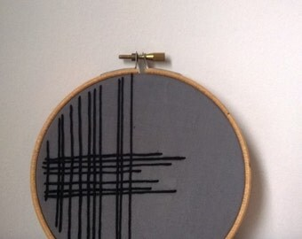 Linear design embroidered hoop art