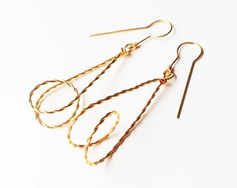 Geometrical gold plated earrings . Offered delivery.