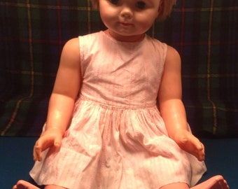 "Uneeda 2S 32"" doll with one dress"