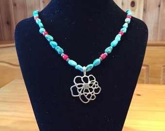 Turquoise necklace with flower pendant