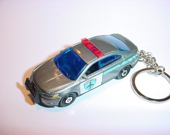 3D Ford Interceptor custom keychain by Brian Thornton keyring key chain finished in silver color trim diecast metal body police 911