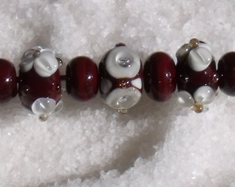Set of nine lampwork beads in chocolate and cream
