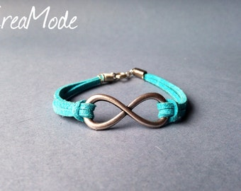 "Bracelet adorned with an ""infinite"" connector, mounted on wire suede."