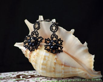 Black beaded earrings with  gold coated beads.
