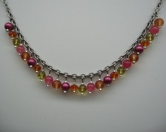 Colorful short necklace. Balls and oranges, pink glass beads, mattes, light or faceted.