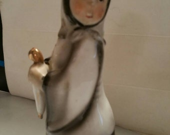 Amish Lady on Rainy Day' Nun?? Figurine.