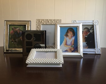 Assorted Silver and White Frames & Photo Books