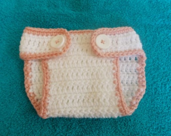White & pink 3-9 months old diaper cover.