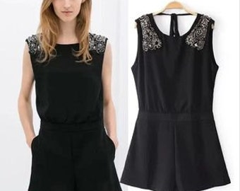 Black fitted Playsuit with beaded shoulders. sizes 8,10,12,