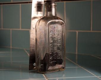 "Antique ""Black Cat"" Brand Stove Polish Clear Glass Bottle"