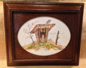 Vignette of an outhouse