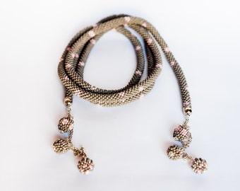 Softness.  Bead Crochet . Necklace. Matte . Metallic . Gray and pink. Lariat