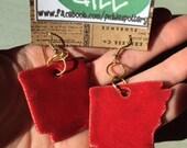 "Handmade red ceramic Arkansas earrings with gold hardware; 1.5"" x 1.5"" charm"