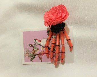 Skeleton hand hair accessory with flower