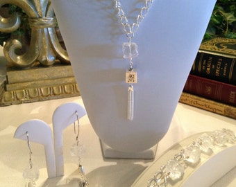 Contemporary icy hot necklace, bracelet, and earrings with some sterling beads and tassel
