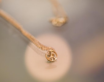 Gold plated beautiful necklace, small peace sign, delicate, modern and unique