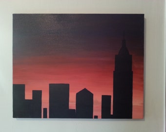 16 X 20 Sunset of a silhouette NYC skyline.