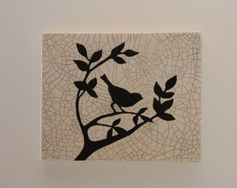 Bird on a brush wall hanging