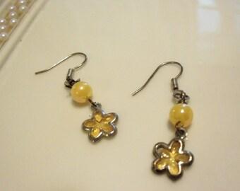 yellow dangle earrings on hooks